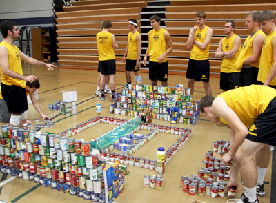 "Men's volleyball team puts the finishing touches on its winning entry during the ""Canstruction"" competition earlier this month"